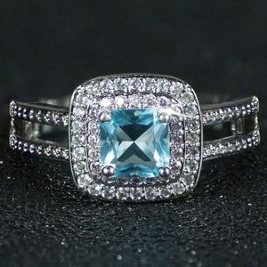 SILVER PINK AND WHITE HALO SQUARE BLUE STONE RING